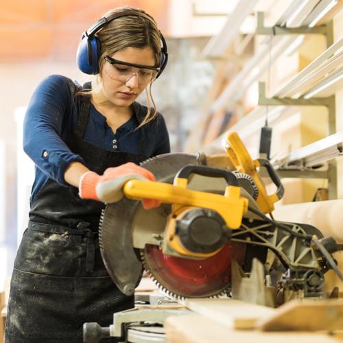girl-cutting-wood